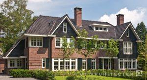 30er jaren villa te Zeist met rode baksteen donkere pannen, schoorstenen en luiken