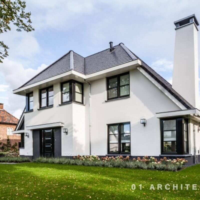 nieuwbouw villa witte gevel zwarte pannen voorzijde