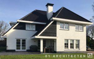 Nieuwbouw villa wit geschilderd donkere dakpannen Brabant